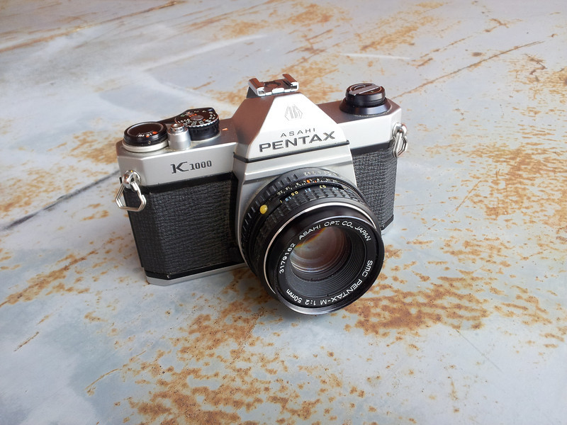 An early copy of the Pentax K-1000 (actually made in Japan).<br /> <br /> Someone had thrown it out! Awesome condition for a 30 year old (give or take) camera! Even had a roll of film in it (noticed after the back was opened) and a working battery!<br /> <br /> Laded a roll of fresh film into the camera and went out to test her out. So far she seemed to be working great. Can't wait to develop the film.<br /> <br /> Ok so it doesn't belong in the 'Scenic' gallery but what the hell. I also added it to the camera collection gallery.