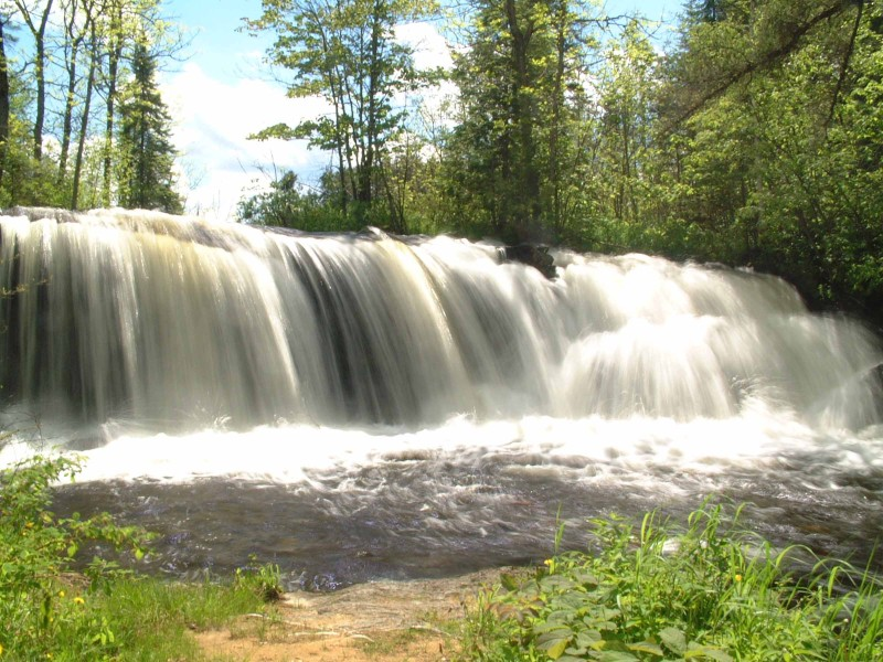 These falls are about an hours drive east of Dryden. Bad day for this sort of shot with the bright direct sunlight, but the clouds cleared up too much by the time I got there. <br /> <br /> This is one of my favourite spots to visit.