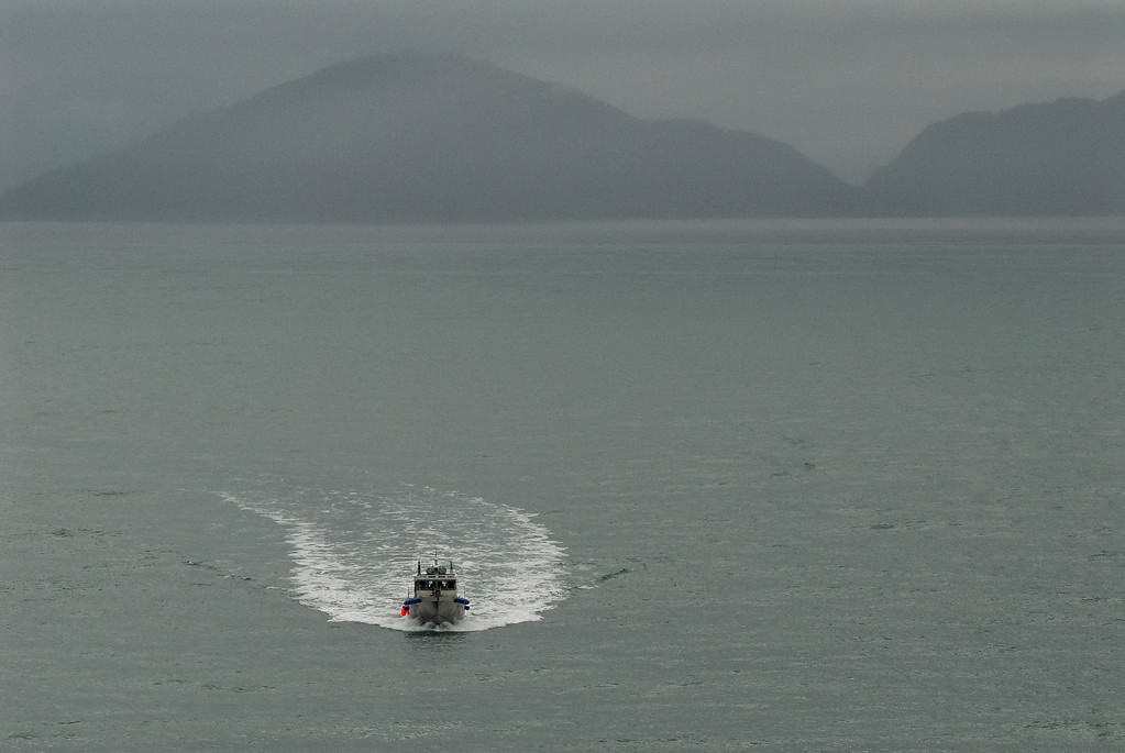 Alaskan pilots approach Island Princess for voyage into Glacier Bay.