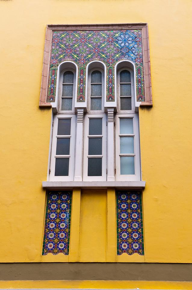 Intricate ornamental tile  details around a window in Old San Juan.