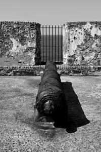 Monochrome image of a cannon at the fortress El Morro, San Juan, Puerto Rico.