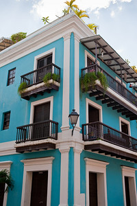 Colorful blue building facade and contrasting balconies in Old San Juan.