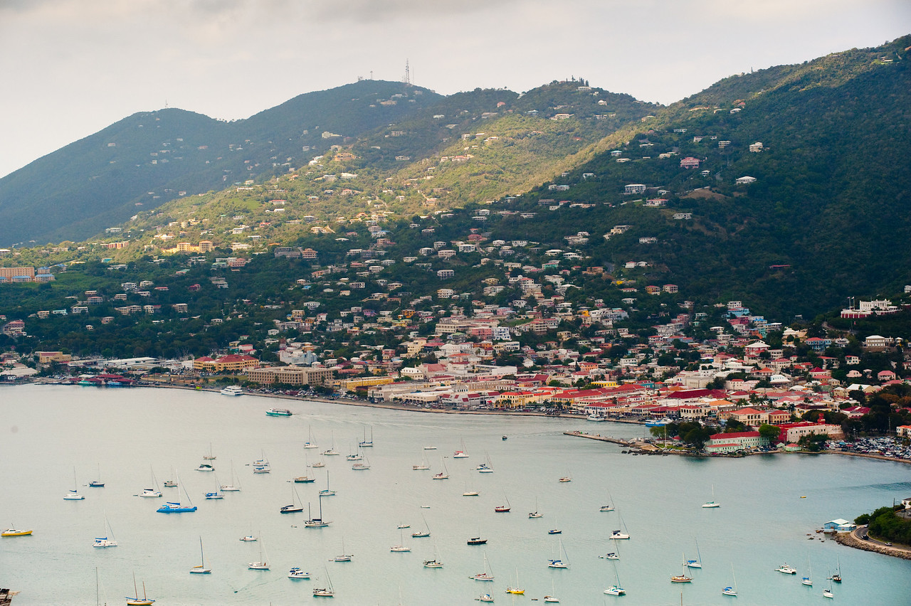 Boats anchored in the harbor at mountainous Charlotte Amalie, St. Thomas.