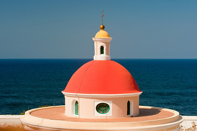 Colorful orange cemetery dome with blue ocean beyond, Old San Juan Puerto Rico.