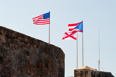 Stars and Stripes and the flag of Puerto Rico fly above El Morro.
