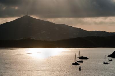 Anchored sailboats in early morning sun at Charlotte Amalie, U.S. Virgin Islands.