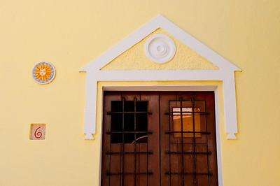 Wooden doors on bright yellow building in Old San Juan.