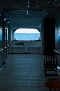 Bright horizon seen through an empty corridor of cruise ship.