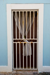 Interesting doorway with drapery behind, in Old San Juan.