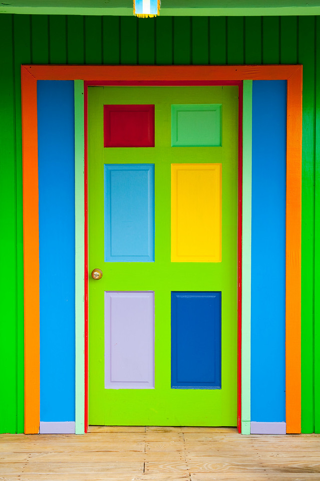 Multi-colored paint brightens doorway of small buidling in the Bahamas.