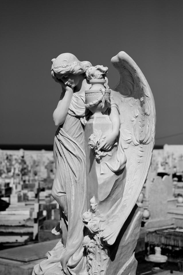 Monochrome image of statue inside the cemetary at Old San Juan.