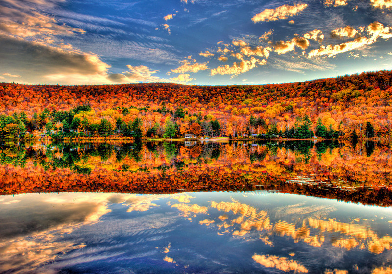 An HDR view of fall foliage reflecting in Lower Baker Pond, New Hampshire.