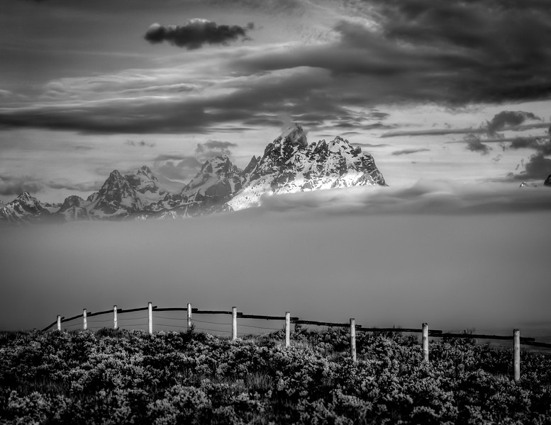 Morning fog in the Tetons, from the split rail fence at Triangle X Ranch.