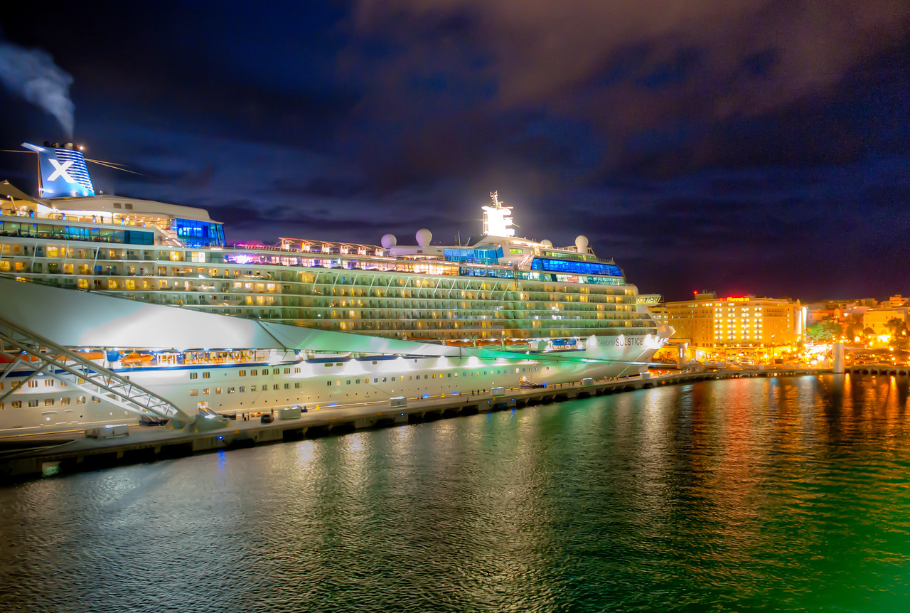 Night image of the cruise ship Celebrity Solstice, docked at Old San Juan, Puerto Rico.
