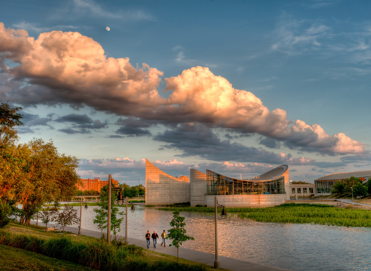 Rising Moon over sunset -colored cloud formation along the Arkansas River in downtown Wichita, Ks.