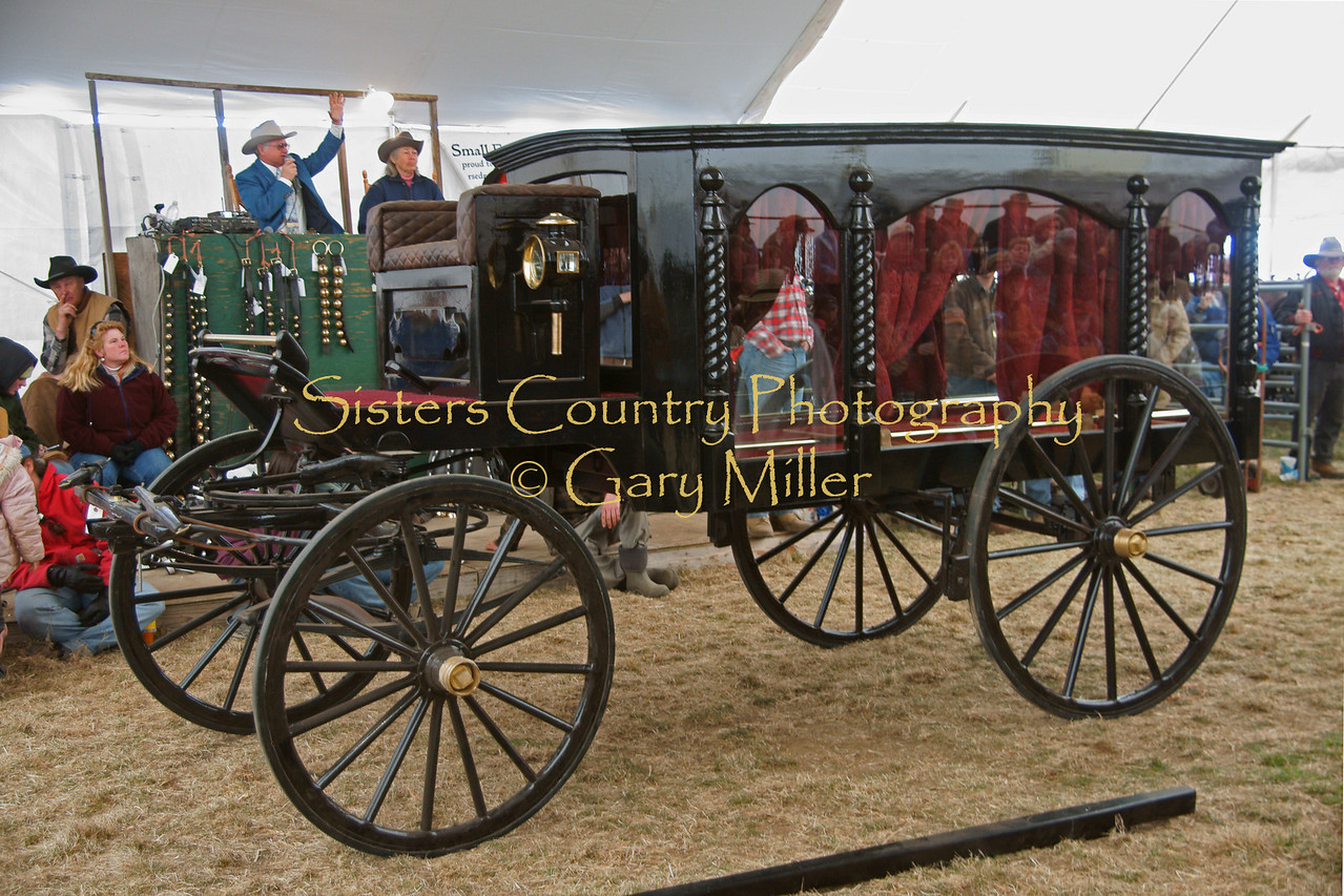 A classic horse drawn hearse is auctioned at the Small Farmer's Journal Horse and Equipment Auction