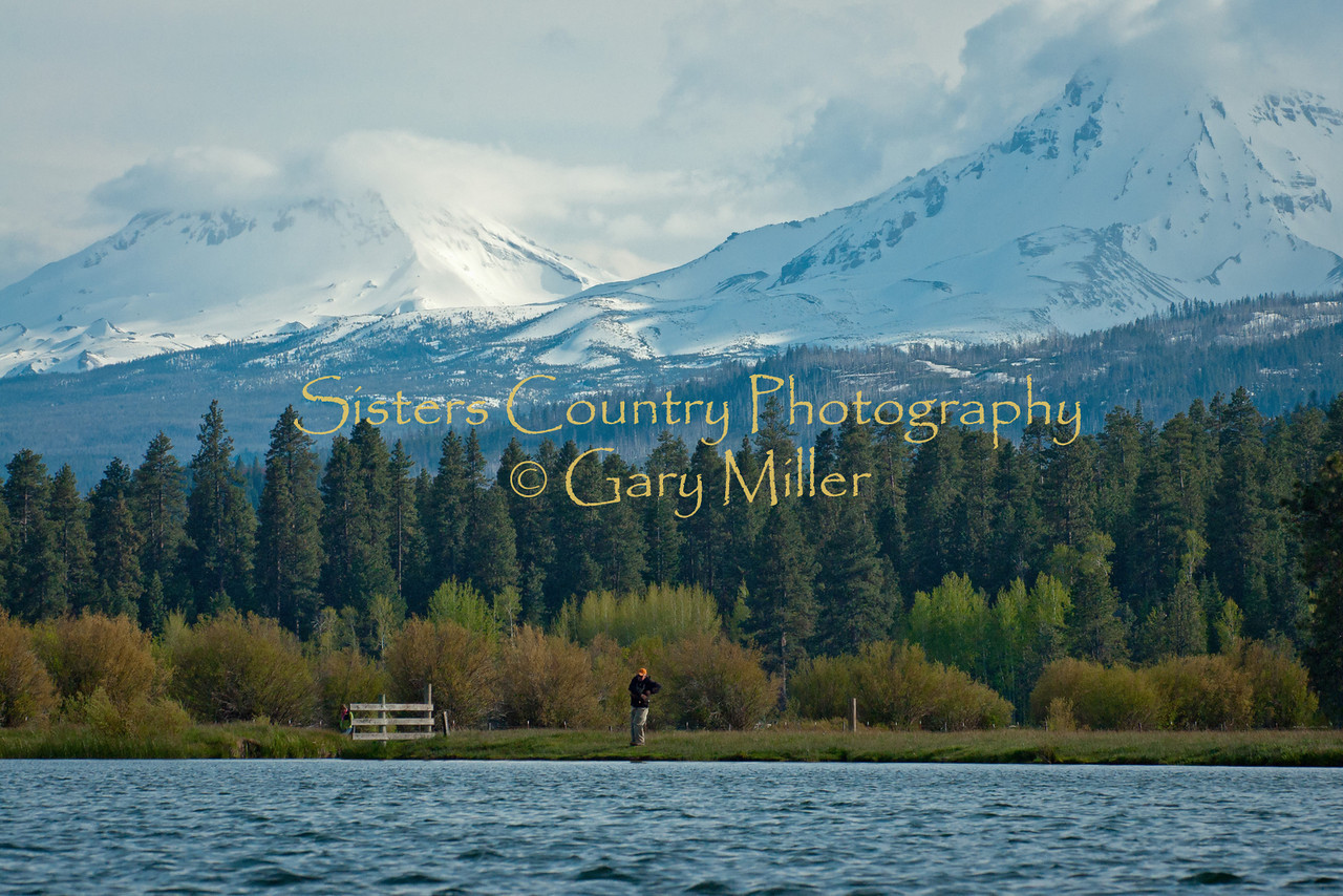 The Spring Fight - A fisherman tests wills landing an early spring trout. Spring tests wills with the fisherman being stubborn to let go of winter. Black Butte Ranch, Oregon, May 30 2011 - Photo by Gary Miller - Sisters Country Photography