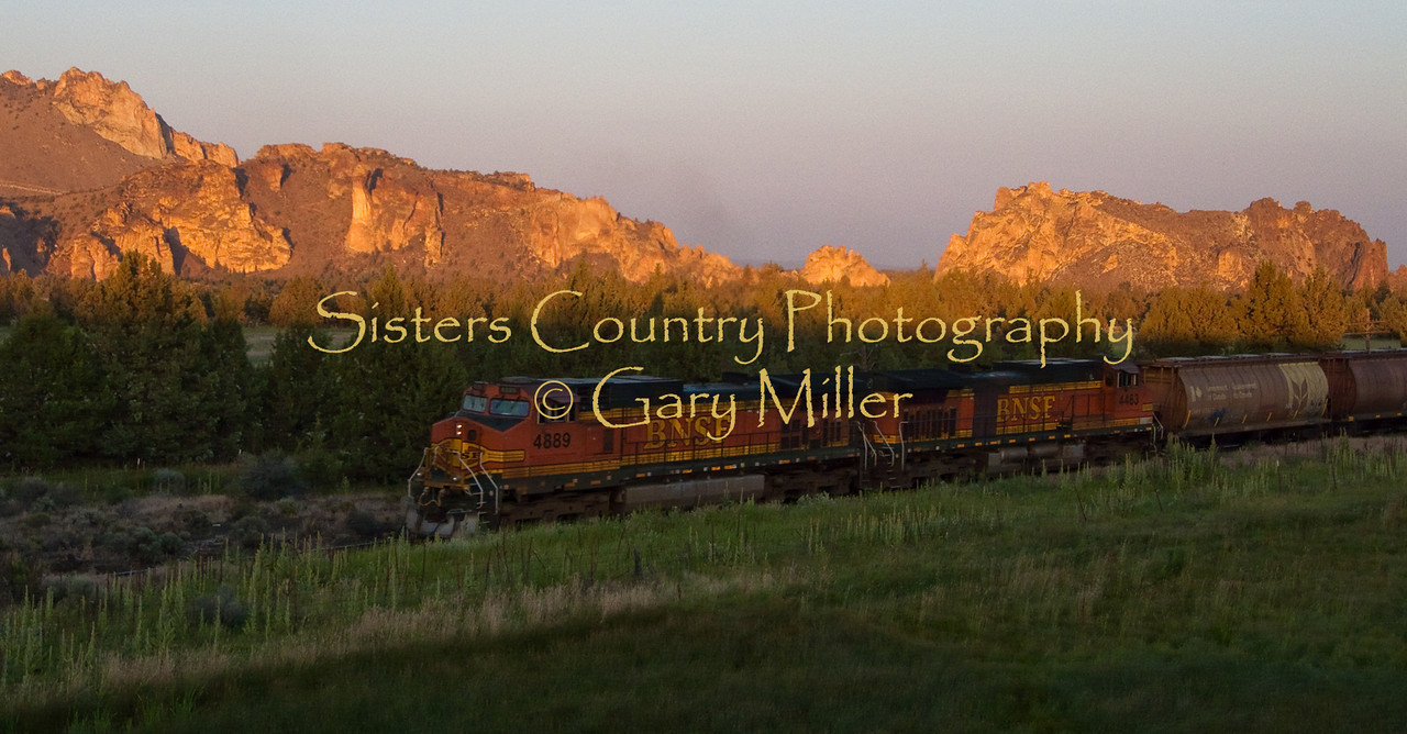 The tail end of a train just skims under the sun setting on Smith Rocks State Park. Deschutes County in Central Oregon. Photo by Gary Miller