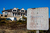 <center>Graffiti or Protest?  <br><br>Someone clearly does not like the concept of this house being built adjacent to the National Seashore.  <br><br>Great Island Trail - 17 March 2011<br>Cape Cod National Seashore<br>Wellfleet, MA</center>