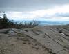 <center>Kearsarge North Hike -- 15 May 2010<br>AMC Boston Chapter<br><br><b><u>Bare Ledges  </u></b><br><br>The summit of Kearsarge North is bare.  The flatland off in the distance is Maine.  </center>