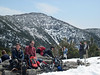 <center>Mount Lafayette Hike -- 1 May 2010<br>New England Over 50 Hiking Group<br><br><b><u>Lunch Break </u></b><br><br>A rocky outcrop at Greenleaf Hut made for a comfortable perch for lunch.  I'm seated comfortably on the left, still in my snow shoes from the ascent to the hut.  From here we switched to microspikes for the summit push.  <br><br>Franconia Notch, New Hampshire</center>