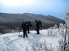<center>North and Middle Sugarloaf - 15 January 2011<br>Crawford Notch, NH<br><br>The Twins  <br><br>The group paused for a break on the summit of Middle Sugarloaf.  North Twin dominates the background.  </center>