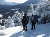 <center>North and Middle Sugarloaf - 15 January 2011<br>Crawford Notch, NH<br><br>Admiring the View  <br><br>We stopped often to admire the view.  That's the shoulder of Mount Hale heading up to the right.  </center>