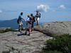 <center>South and Middle Moat - 14 August 2010<br>New England Over 50 Hiking Group<br><br>Standing on the Edge  <br><br>The group paused to take in the views at the summit of Middle Moat.  </center>