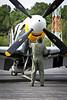 "Gene Soucy checks the P-51D, ""Dakota KId"" before take off."