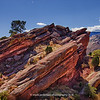 Red-Rocks_001 <br /> This vista may be familiar to visitors of the world famous Red Rocks Amphitheater. It is near creation rock, on the North side of the Amphitheater. <br /> The red sandstone found throughout Red Rocks Park is geologically identified as belonging to the Fountain Formation. The rocks were formed about 290-296 million years ago when the Ancestral Rocky Mountains were eroded during the Pennsylvanian epoch. Later, uplift during the Laramide orogeny tilted the rocks to the angle at which they sit today. <br /> <br /> The rock formations of red rocks are timeless, and ever etched upon the memories of any vistor.