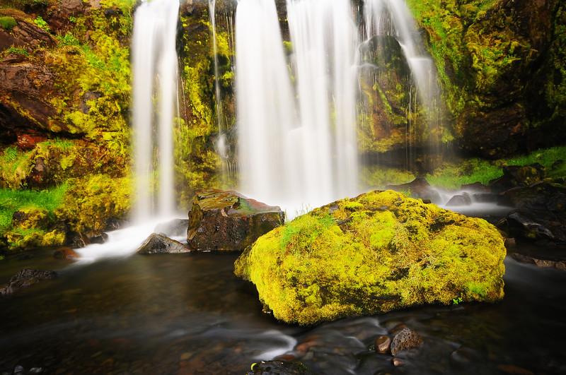 A moss covered boulder in remote waterfall near Hjardjarfell, Northwest Iceland.