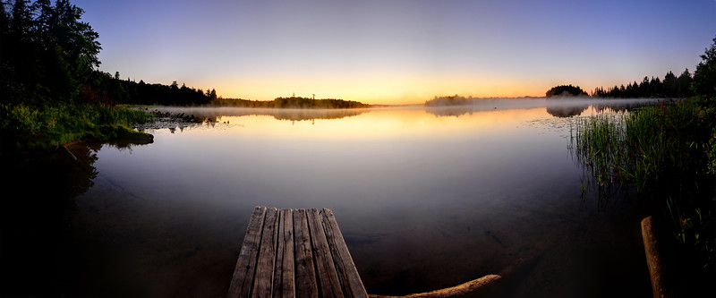Boat dock at sunrise over a lake in Northern Wisconsin