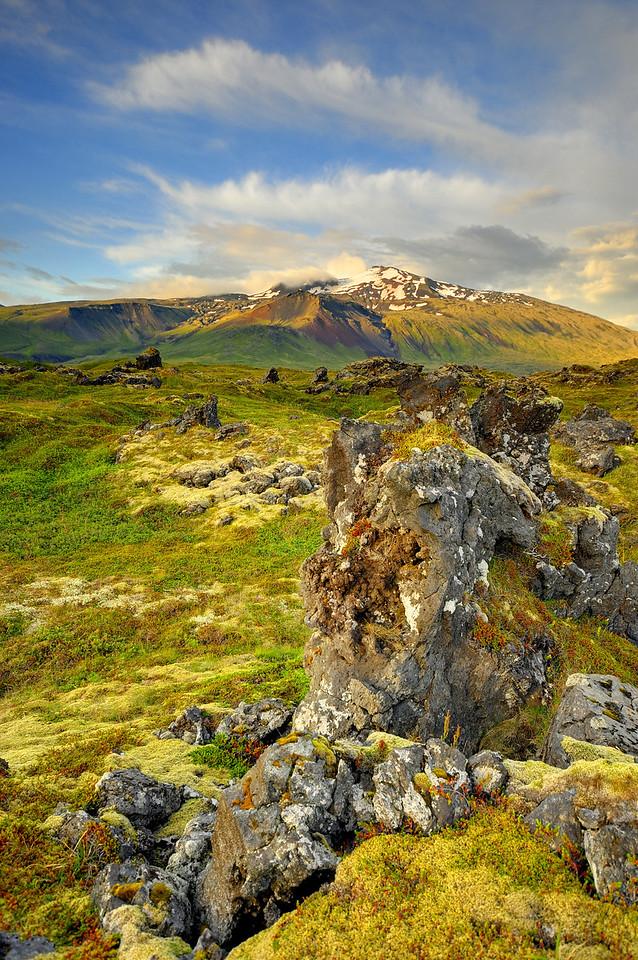 Snaefellsjoekull mountain and glacier across a lava field in Northwest Iceland.