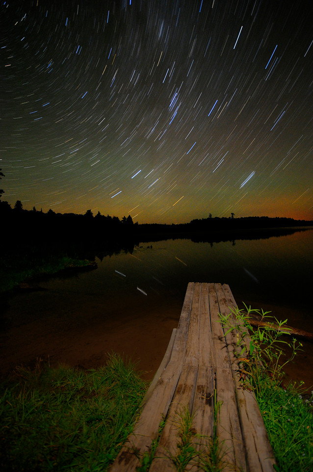 Boat dock in front of a starry night sky on Big Lake, Wisconsin.