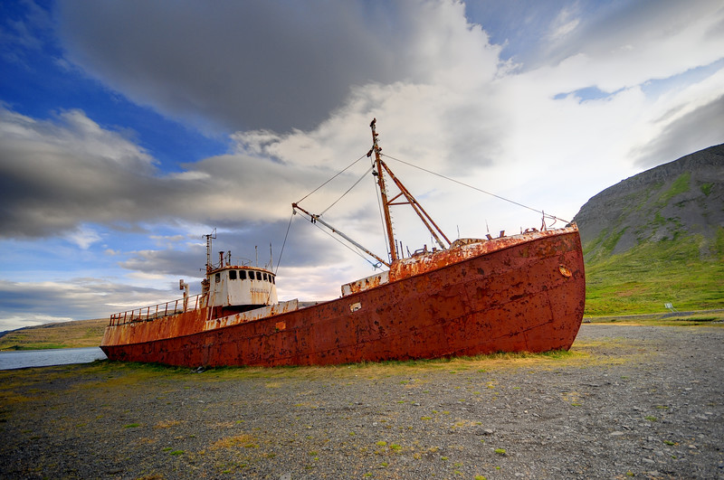 An old ship on a sea shore in Northwest Iceland.