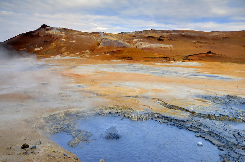 Geothermal mud pool and volcanic hillside near Myvatn, Iceland.
