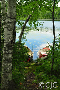 Two Canoes by The Lake (Portrait)