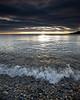 Tiny wave action on a rocky shoreline.  Ogunquit, Maine.