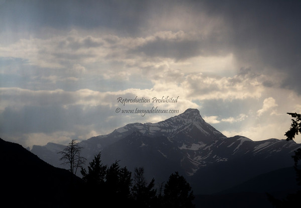 Sunset in the background, summer squall in the foreground. Invermere, BC. July 2012