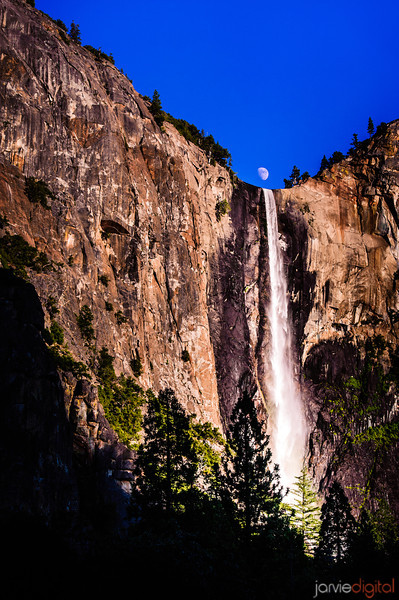 The moon rises right over Bridevale falls in Yosemite National Park