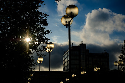 Light globes catch the sun's light in the car park of an empty office block in Alperton, London. September 04, 2017. Photo: Edmond Terakopian