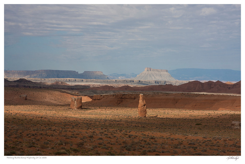 Rock formations along highway 24, Factory Butte can be seen in the background