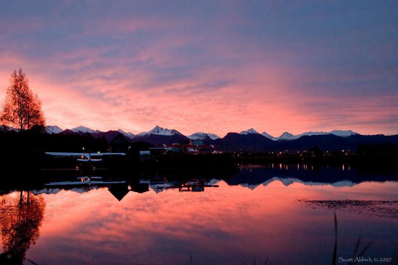 Sunrise in winter time over the Chugach Mts. Lake Hood Seaplane base, Alaska.