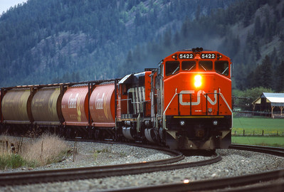CN Westbound grain train approaches Kamloops, BC  1986.