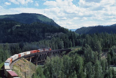CN container train Eastbound along the Yellowhead Highway crosses the North Thompson River