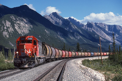 Over 100 empty grain hoppers heading East from Jasper, Alberta 1988.