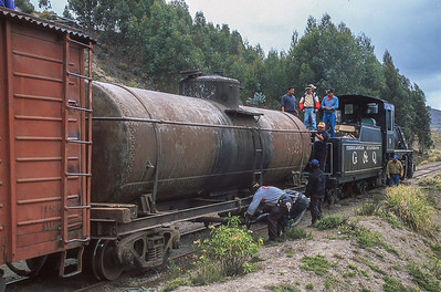 Pulling more oil in the tender of our second train, #53 picked up at Riobamba, as we approach the Avenue of Volcanoes.