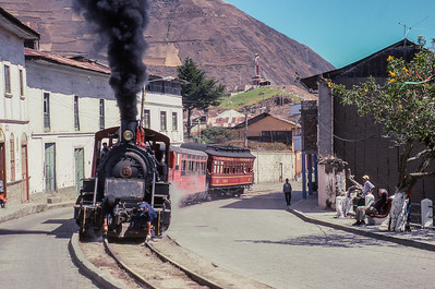 Passing through Alausi, the tracks are sanded by hand for traction.