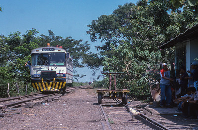 Railbus passes through a small station between Duran and Yaguachi.