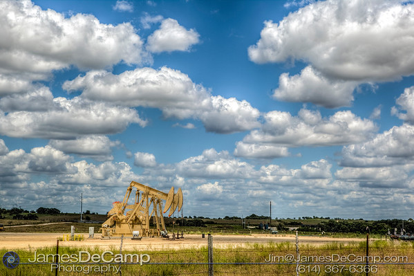 Oil wells working in the scub brush of Lavaca County Texas photographed Wednesday August 3, 2016. (© James D. DeCamp | http://www.JamesDeCamp.com | 614-367-6366)